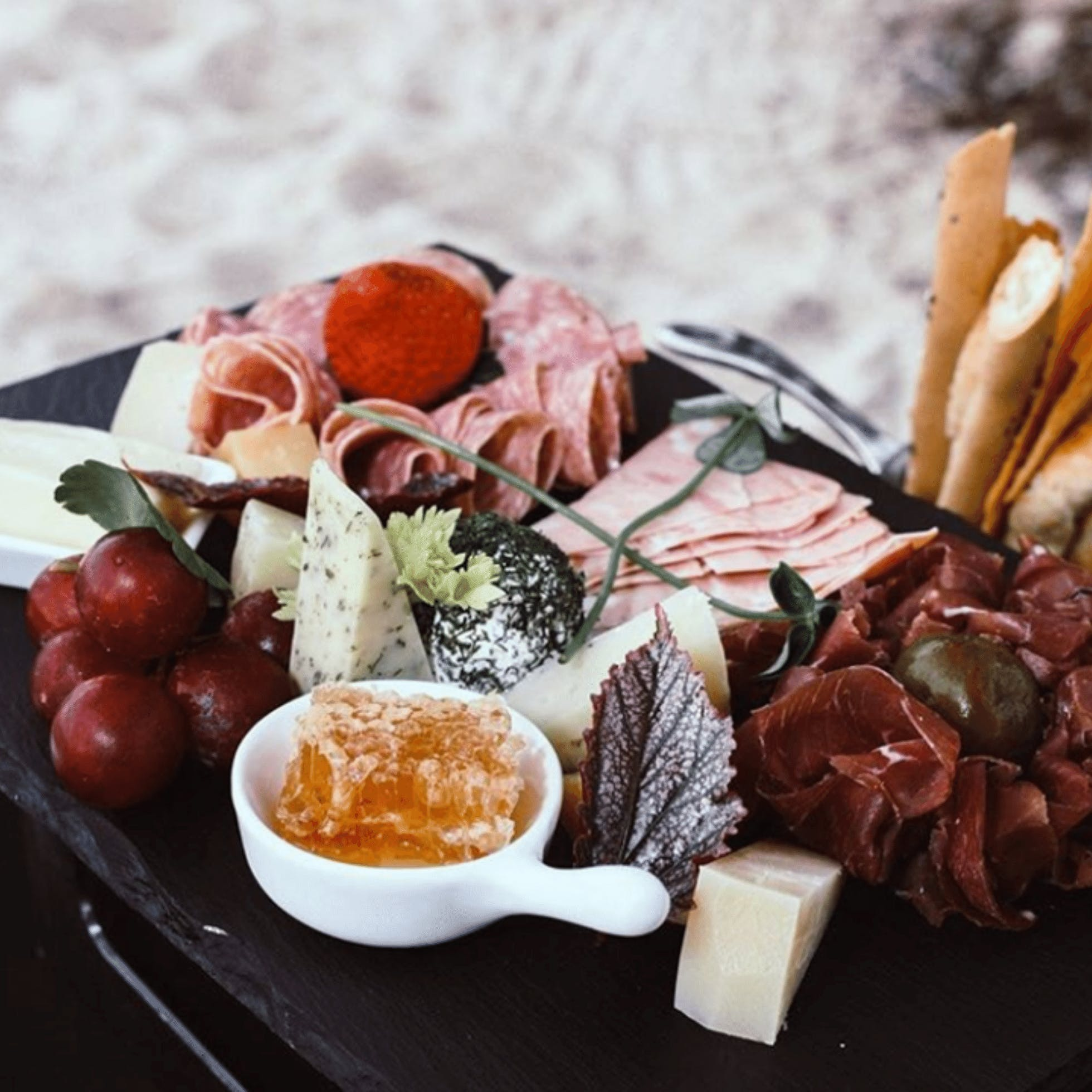 Charcuterie Board with Cheese, Meat, and Fruit at Bateau in Richmond, VA
