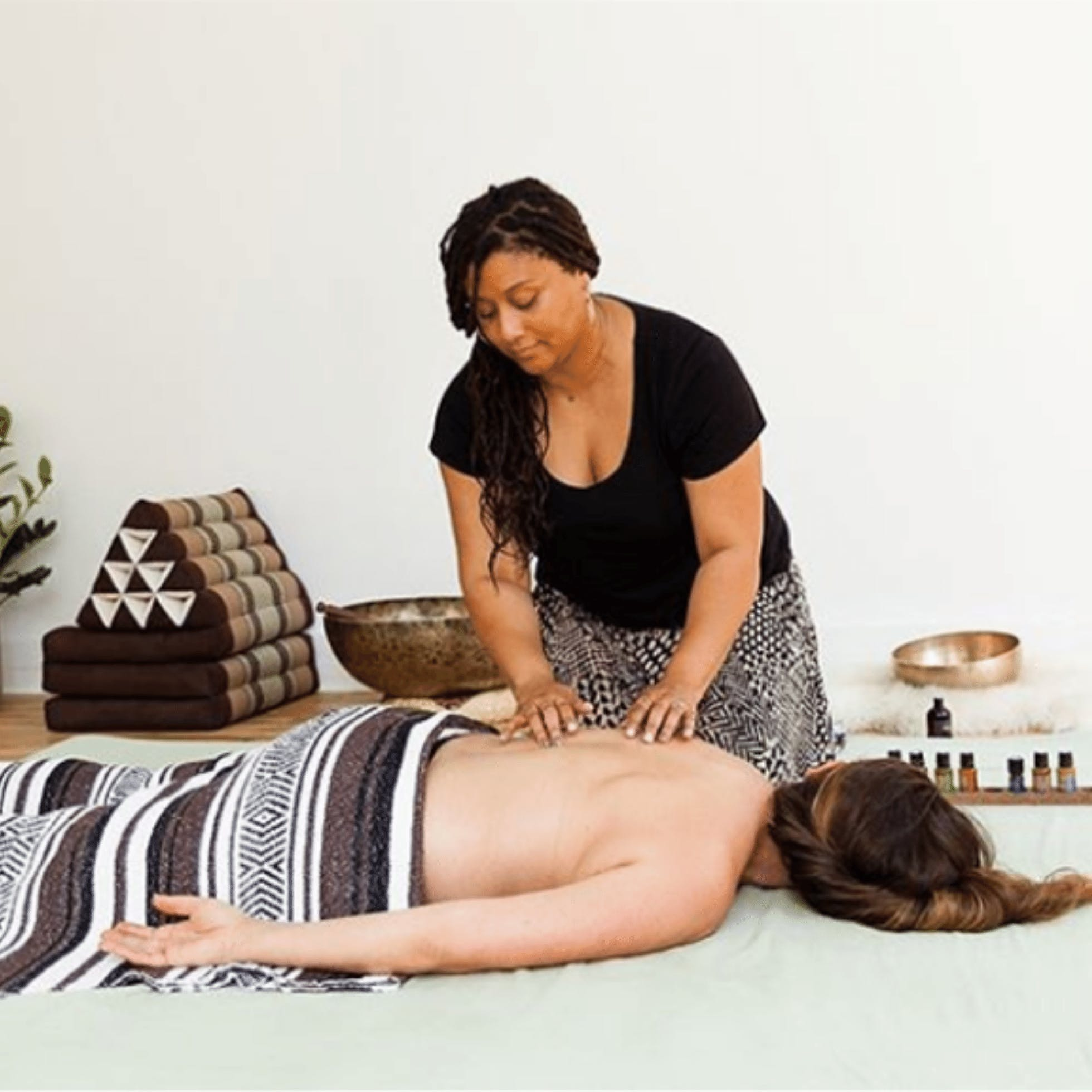 Woman massaging person at Lucid Living in Richmond VA